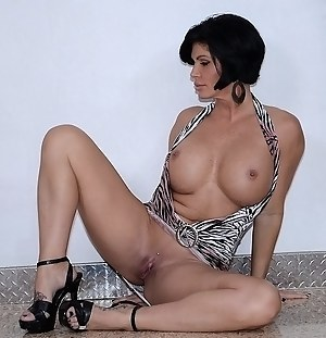 Busty queen is taking off her sexy dress and showing her fake tits. Her young lover is penetrating her sweet holes with great excitement.